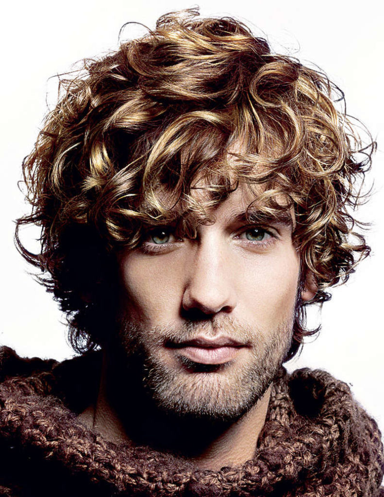 A styling of men's curly hair